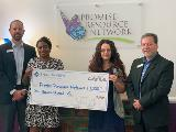 Sharonview delivers check to the Promise Resource Network